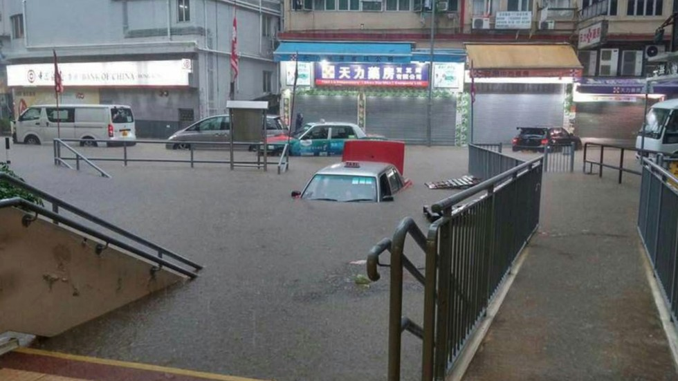 Hong Kong Grinds To A Halt Amid Rainstorm That Leaves