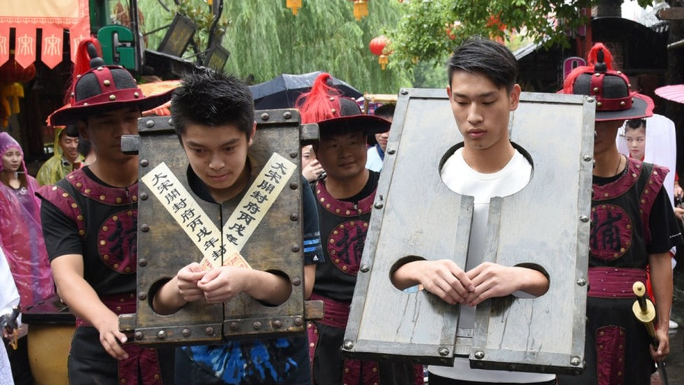 Tourists Put In The Stocks At Chinese Theme Park  South -7971
