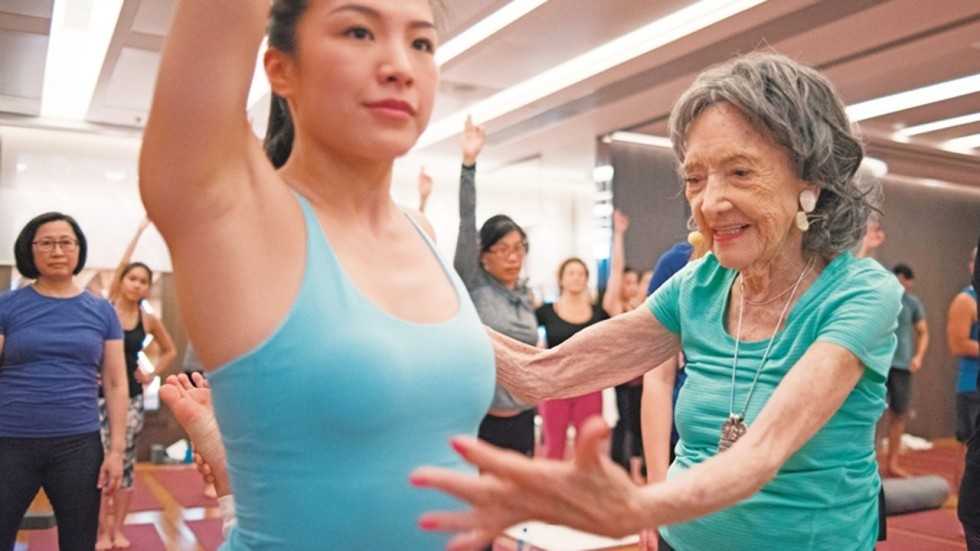 Mature woman doing yoga on cruise