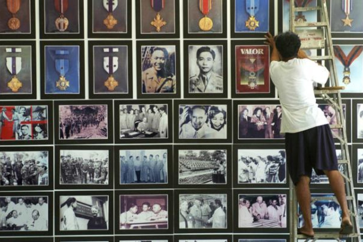 Above: caretaker arranges pictures of Ferdinand Marcos at the former president's mausoleum and museum in Batac, Ilocos Norte. Below: completed in 1710, Paoay Church, a Roman Catholic parish church in Ilocos Norte province, was designated a Unesco World Heritage site in 1993. Photos: AFP, Corbis