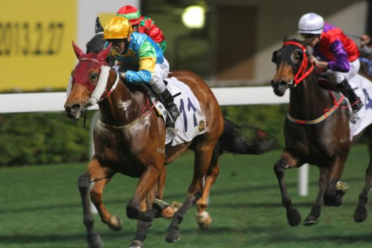 Eddy Lai shrugs off an earlier fall to send Spirit Soaring over the line to win race seven at Happy Valley last night. Photo: Kenneth Chan