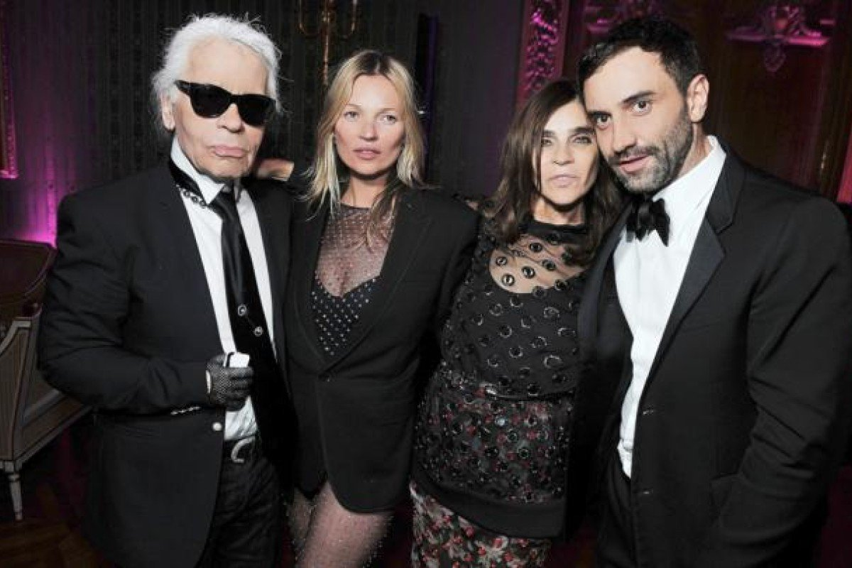 Carine Roitfeld (second from right) hosts a launch party for her CR Fashion Book 2, attended by Karl Lagerfeld (left), Kate Moss, and Riccardo Tisci.