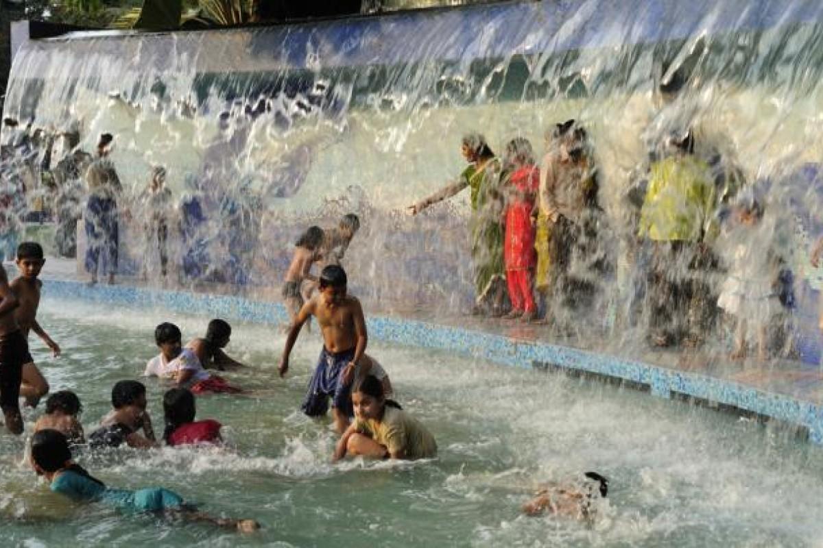 Children cool off in a public park.