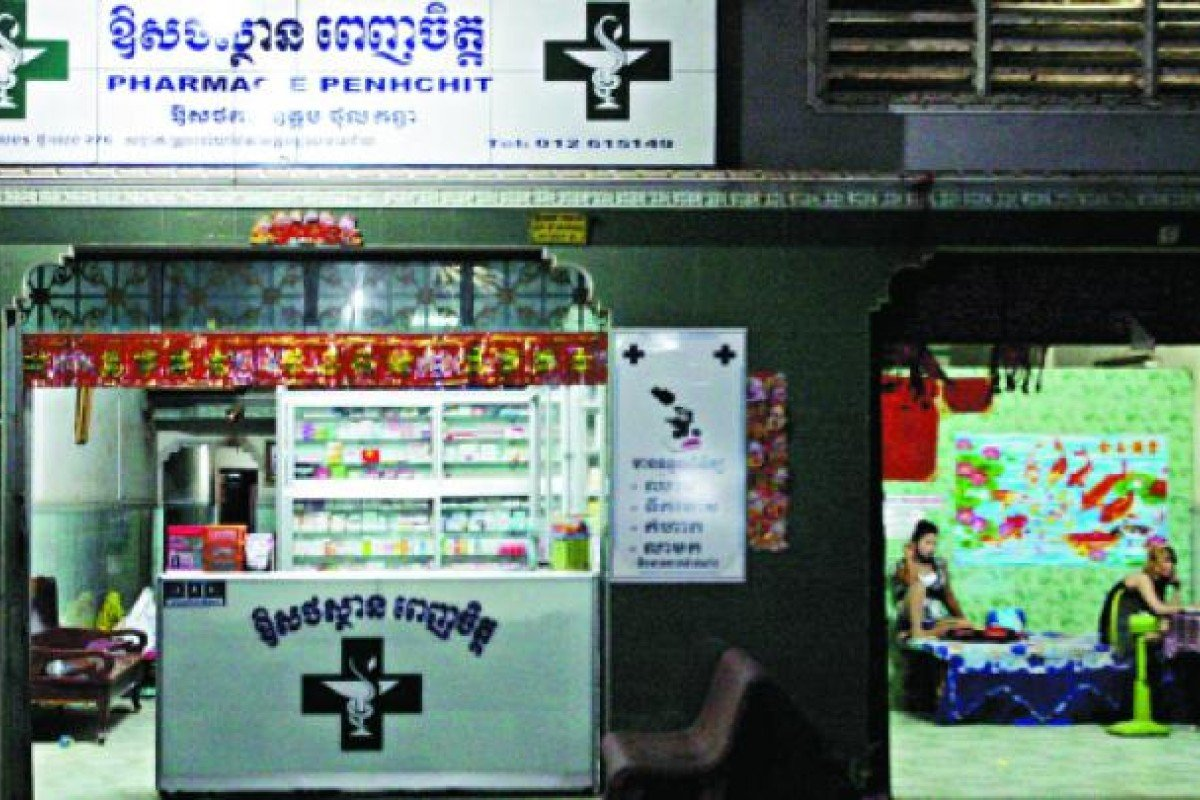 A brothel operates next to a pharmacy in Poipet.
