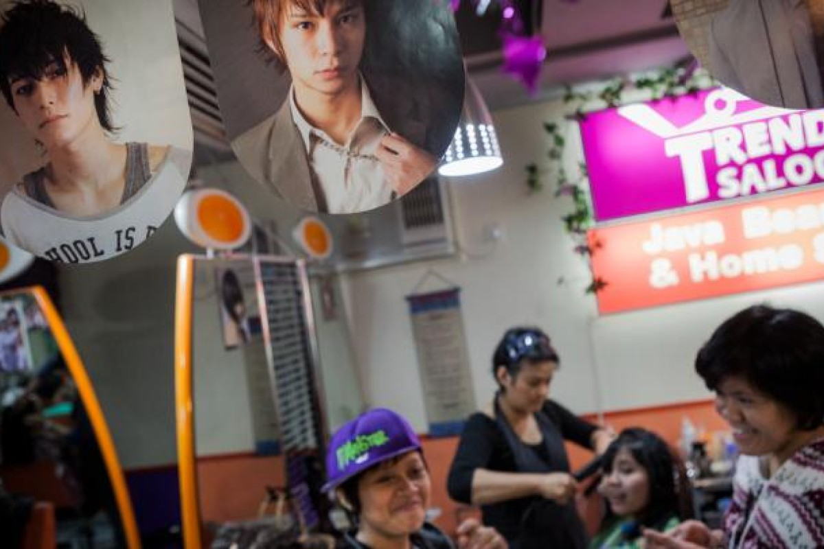 Pictures of South Korean and Japanese male pop stars hang from the ceiling of Trendy Saloon. Located on Sugar Street, Causeway Bay, the salon serves Indonesian helpers almost exclusively. Hair stylist Remi claims nearly half its customers ask for a male haircut.