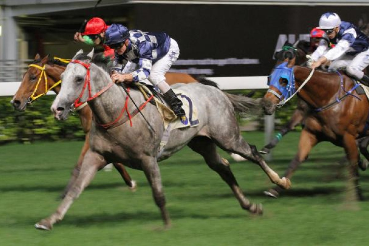 Zac Purton drives home Choice Treasure to complete a treble for trainer Dennis Yip at Happy Valley last night. Photo: Kenneth Chan
