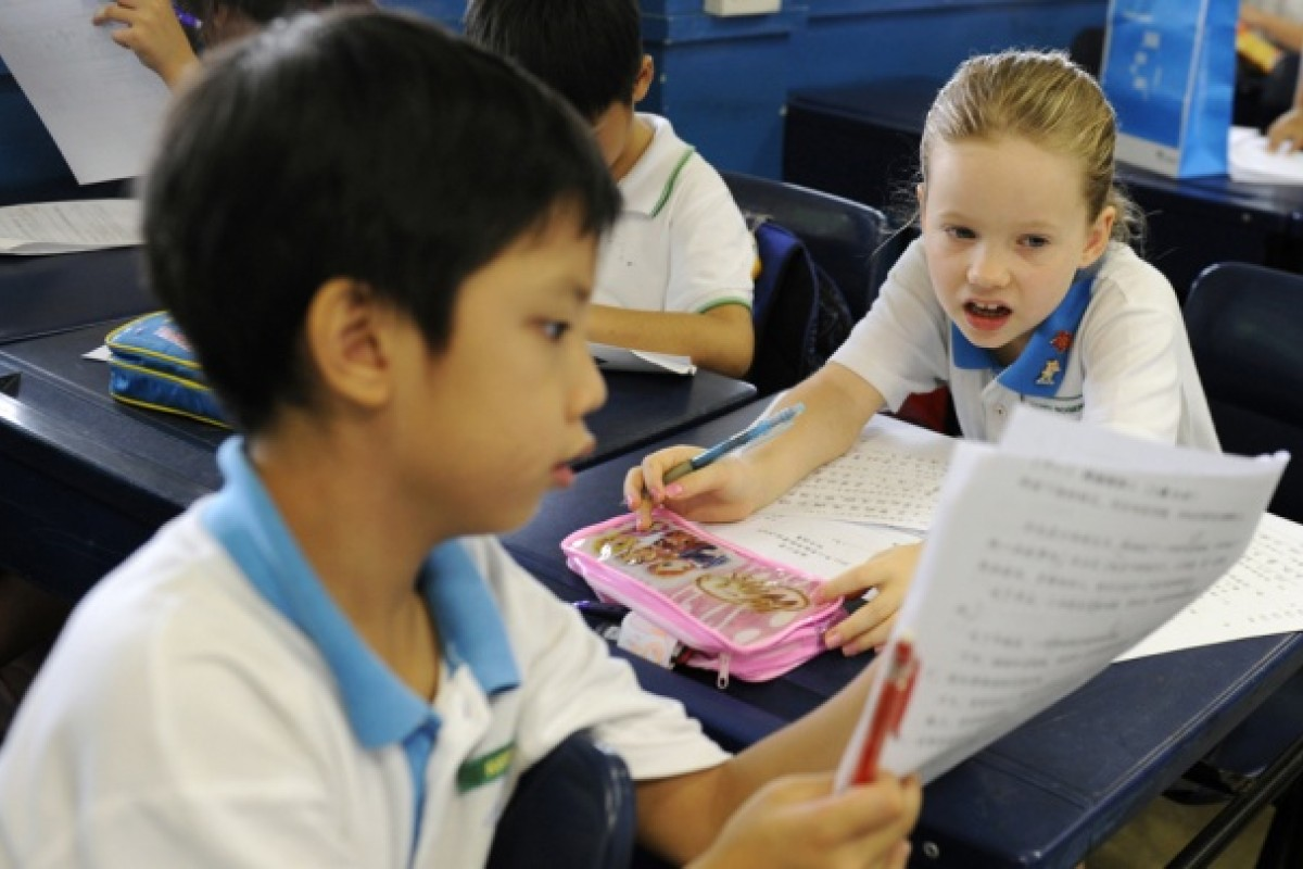 Star pupil Happy attends a Putonghua class at Singapore's Nanyang Primary School, in 2011.