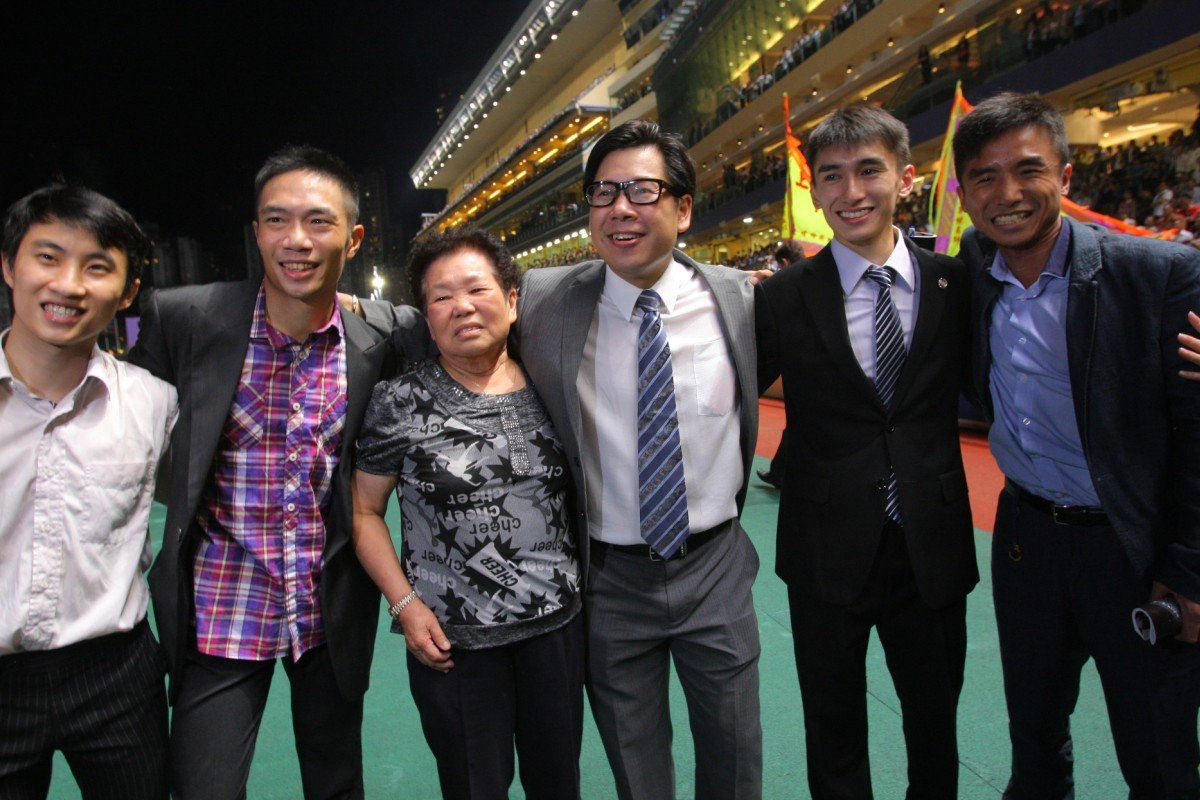 Dennis Yip is joined by his team after a dramatic night's racing.