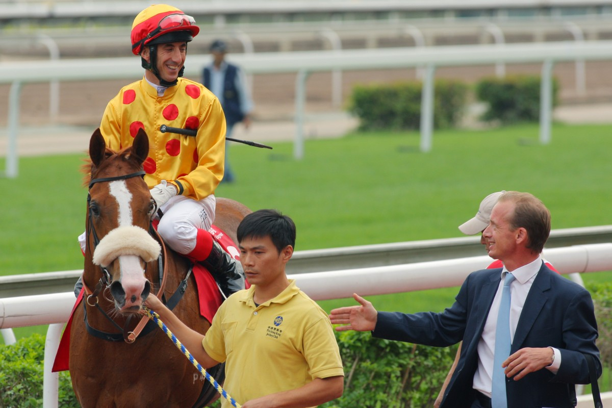 Richard Gibson and Olivier Doleuze combined to take victory in the Jockey Club Mile with Gold-Fun. Photo: Kenneth Chan