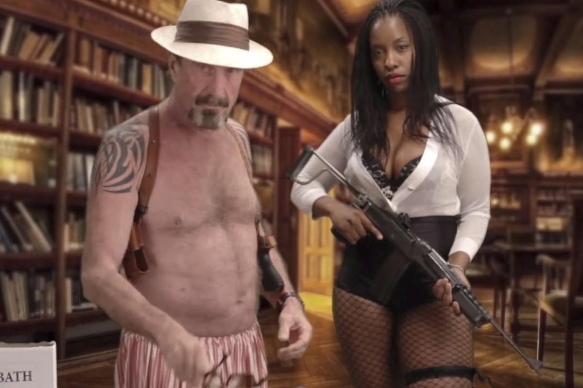 McAfee shows his contempt for his namesake antivirus software in a spoof YouTube video starring current girlfriend Janice Dyson.