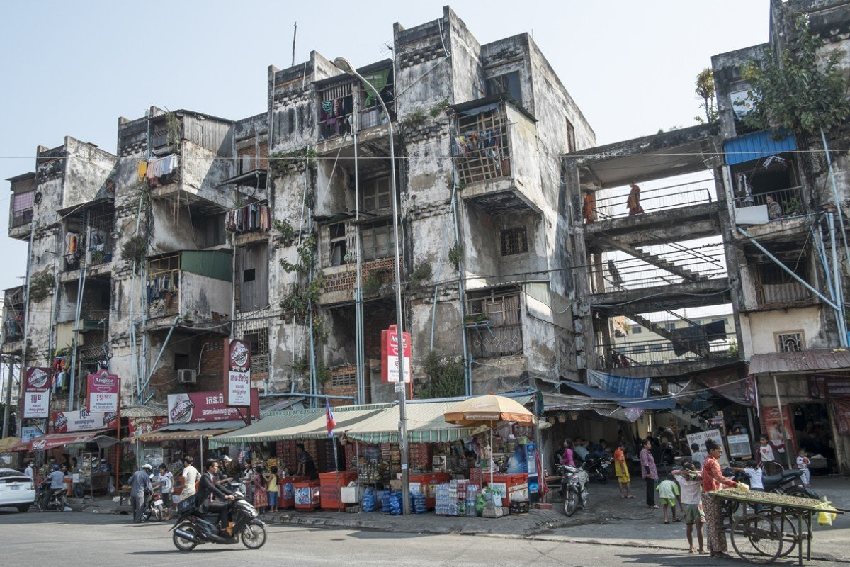 Long-term neglect has seen Phnom Penh's White Building, the construction of which was overseen by Vann Molyvann, become little more than slum housing.