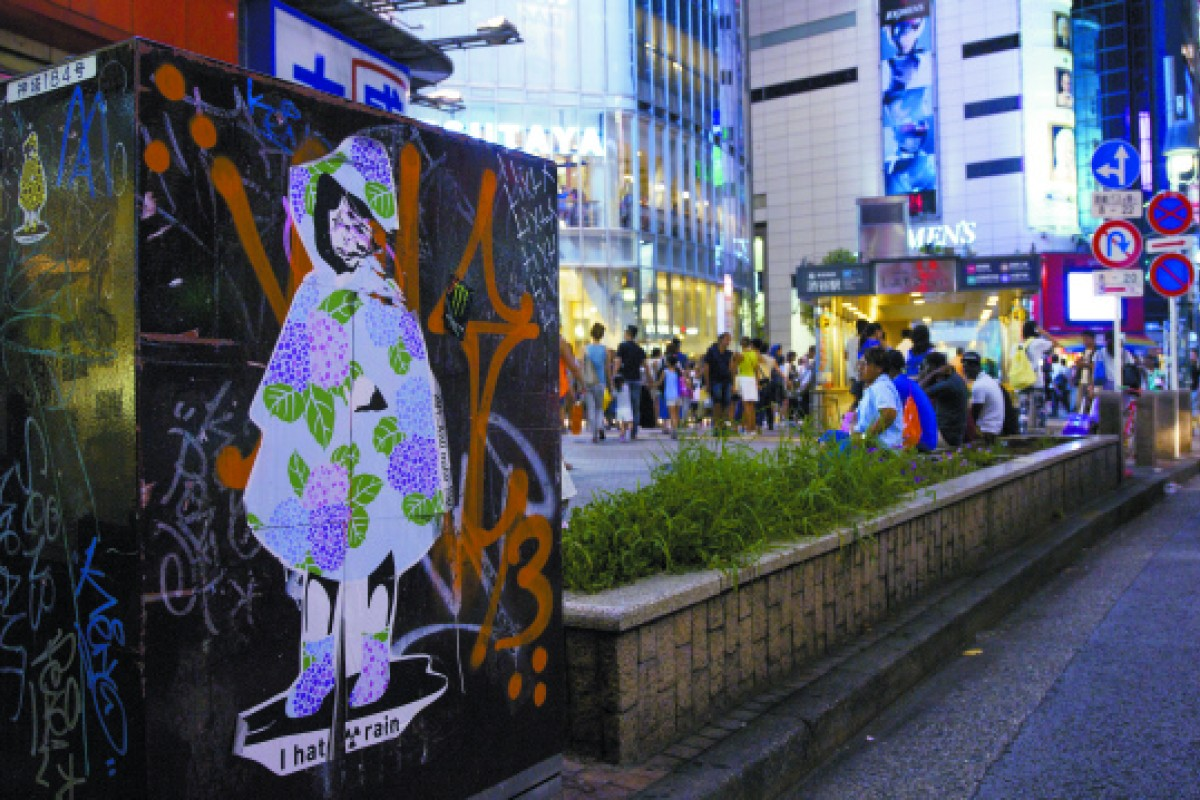 Stickers by 281 Anti Nuke on the streets of Tokyo include a work from the I hate rain series.