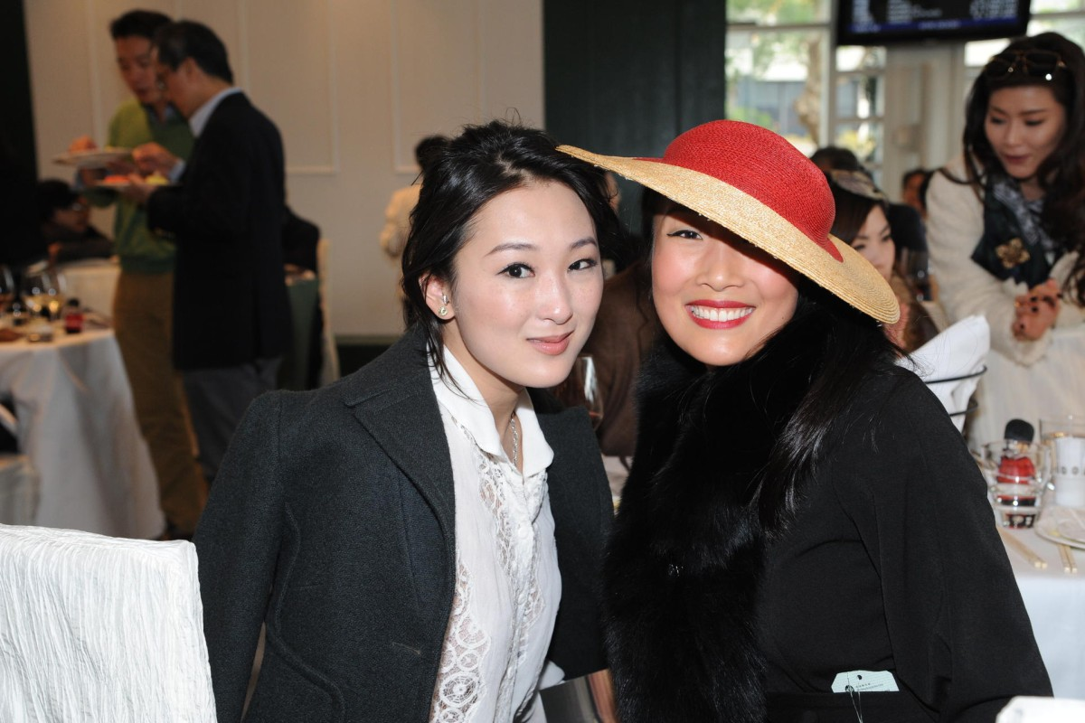 Antonia Li and Chelsea Chau, with Chau channelling hat chic at the soiree