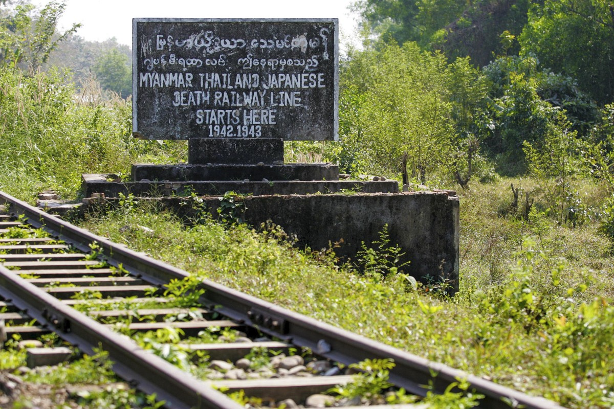 "A sign marking the beginning of the Japanese ""death railway"", in Thanbyuzayat."
