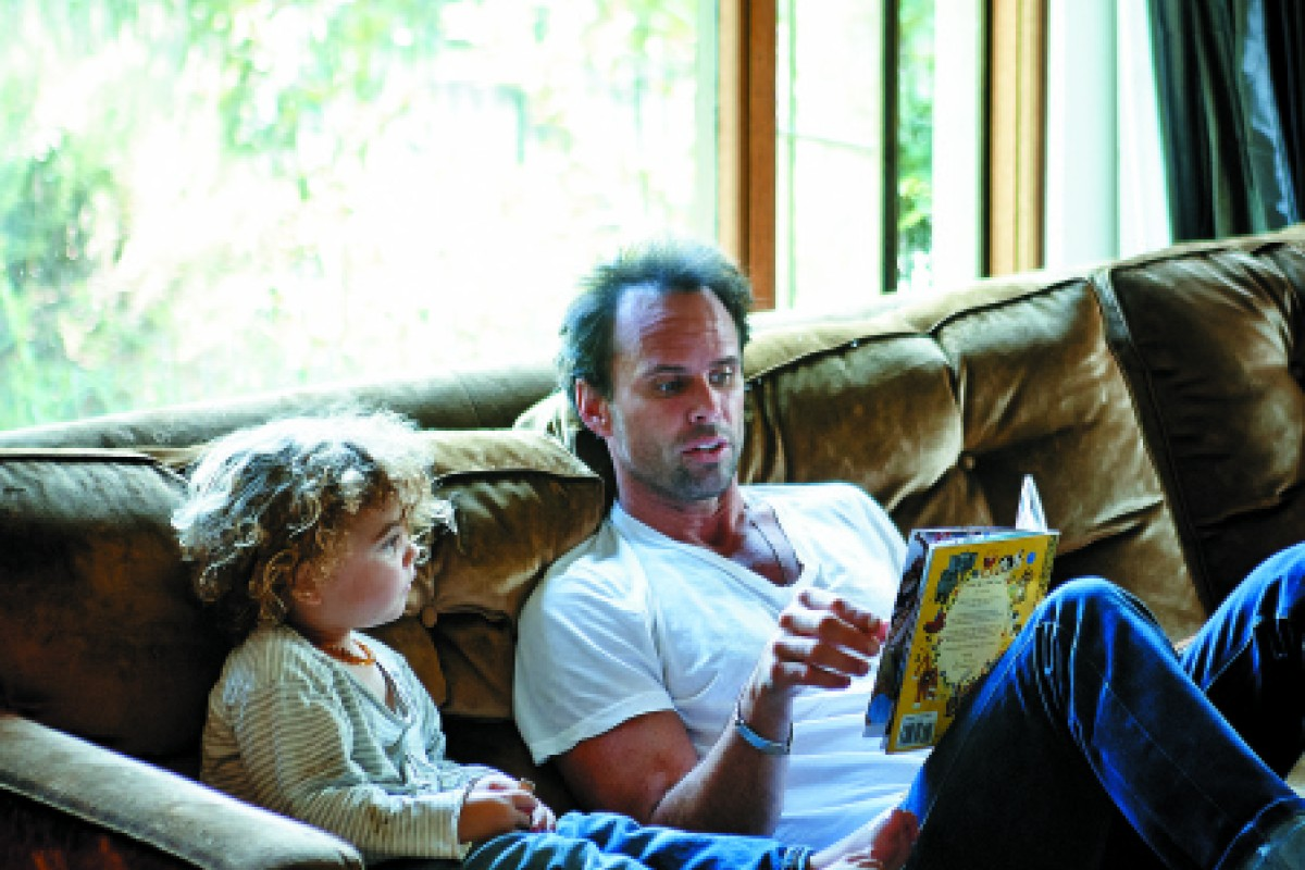 Goggins relishes the luxury of relaxing and reading to his son. Photography Martin Lof / Living Inside