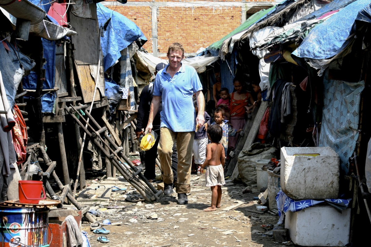 Scott Neeson, founder of the Cambodian Children's Fund, in a Phnom Penh slum.