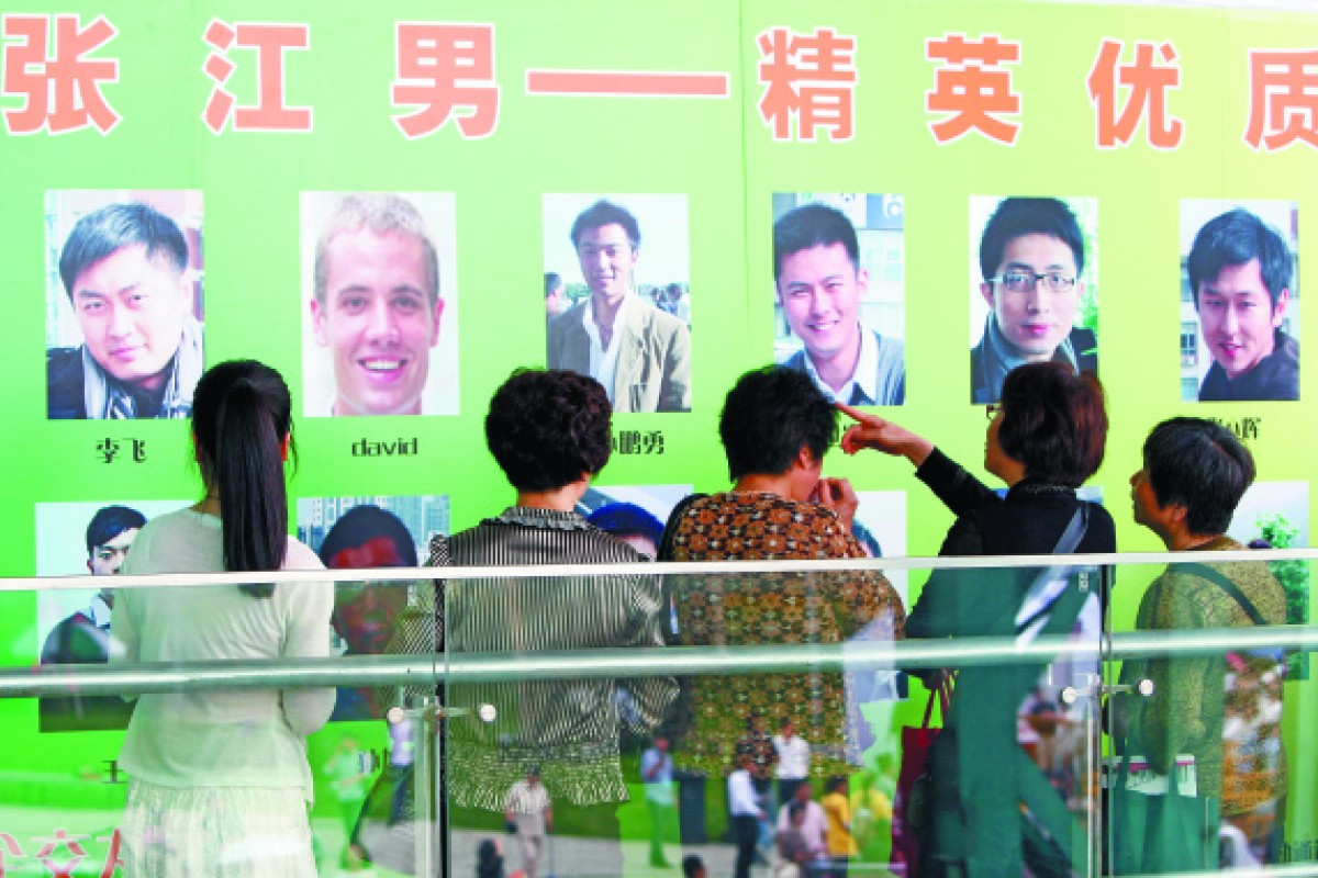 Parents of 'shengnu' assess available men at a matchmaking event in Shanghai.