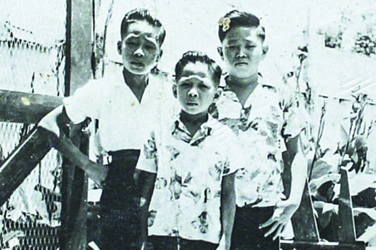 Leo with brothers Euston and Glen in Kingston in the 50s.
