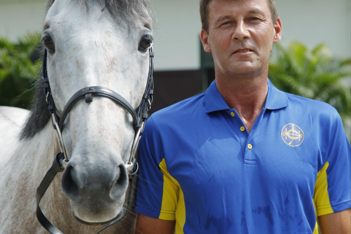 Beas River's senior showjumping trainer Joachim Heidenreich with one of the horses he is helping to rehabilitate. Photo: SCMP Pictures
