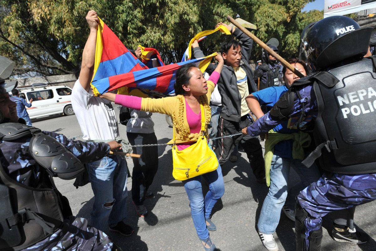 Nepalese riot police arrest Tibetans during a protest in Kathmandu in 2012 to mark the 53rd anniversary of the 1959 Tibetan uprising against Chinese rule. Photos: AP