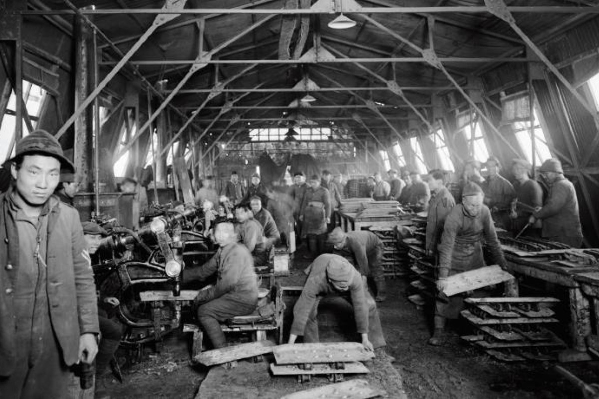 Members of the Chinese Labour Corps carryout riveting work at the Tank Corps Central Workshops, in France, during the first world war.