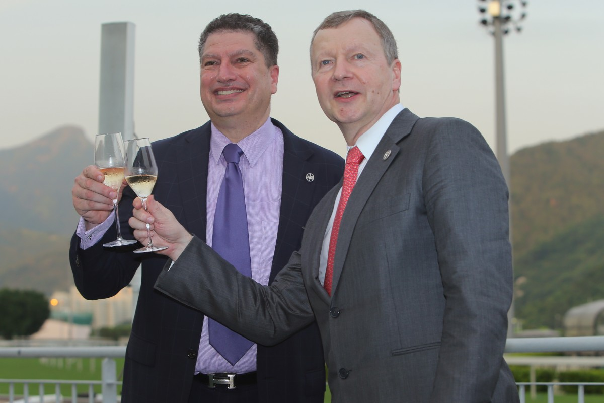 The Jockey Club's chief executive Winfried Engelbrecht-Bresges (right) and executive director of racing Bill Nader toast last season's success. Another milestone has been reached with the introduction of commingling with Australia and New Zealand. Photo: Kenneth Chan