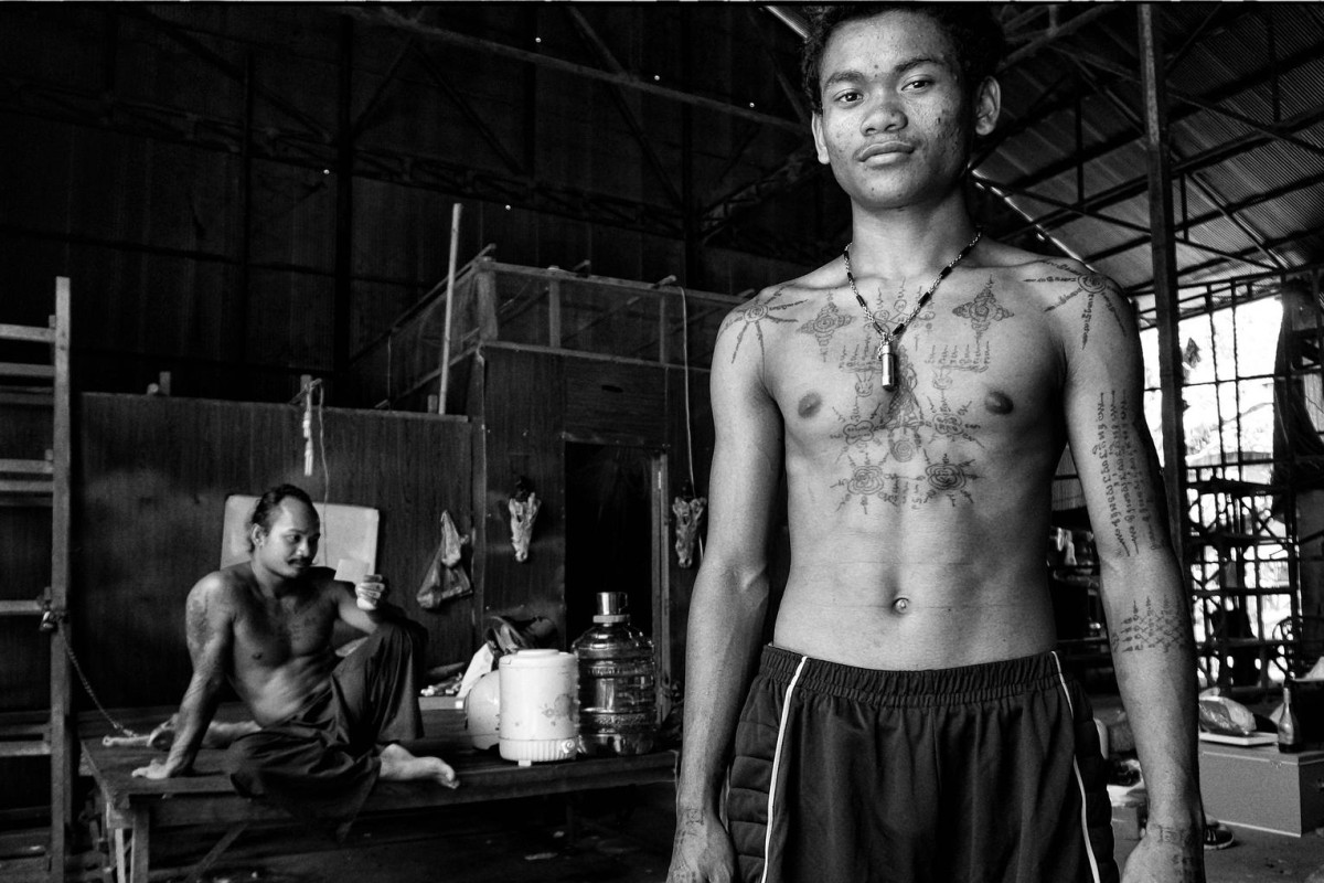 A student of tattoo master Teven Say (left) displays his ink in his mentor's studio in Siem Reap, Cambodia. Photos: Nathan Thompson; Emily Townsend
