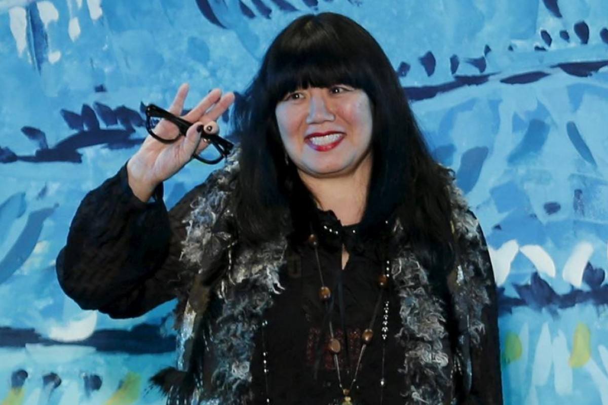 Anna Sui acknowledges the applause after presenting her latest collection in New York in September. Photo: Reuters