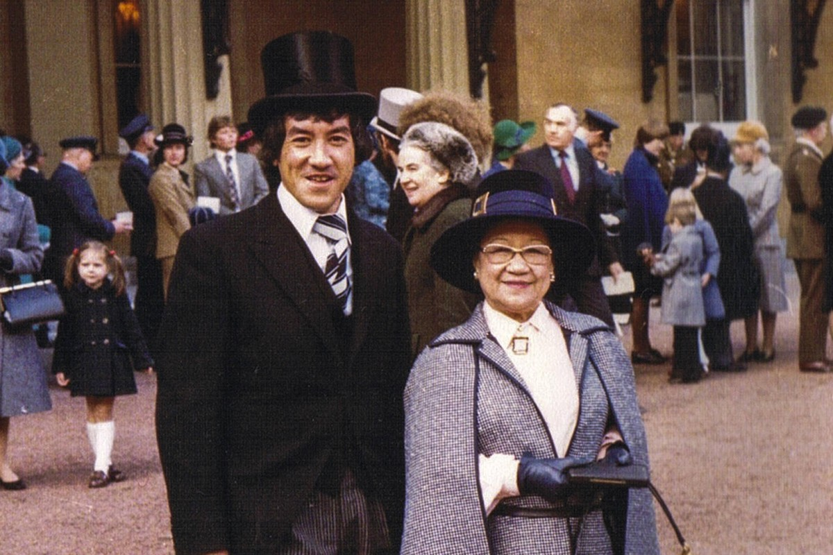 Writer Ian Gill with his mother, Louise Mary Gill, at London's Buckingham Palace, in 1977, to receive her MBE. Photos: courtesy of the Gill family