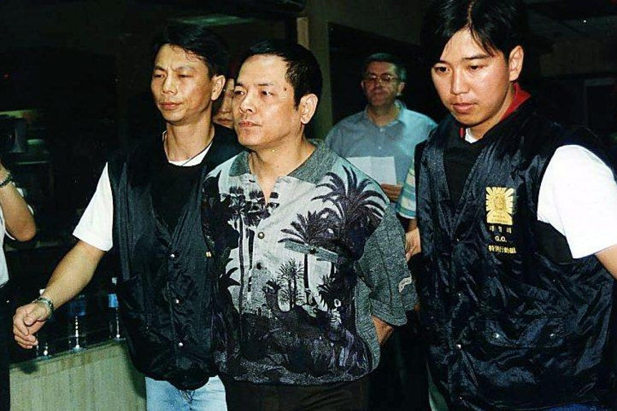 Wan Kuok-koi is escorted by Macau Police to court in 1998. Photo: Handout