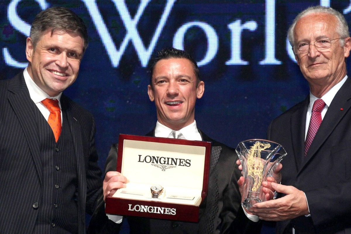 Franki Dettori, flanked by Longines vice-president Juan-Carlos Capelli (left) and Louis Romanet, chairman of the International Federation of Horseracing Authorities, is all smiles after being awarded a trophy and watch in winning the second Longines World Best Jockey title at a ceremony in Hong Kong. Photo: SCMP Pictures