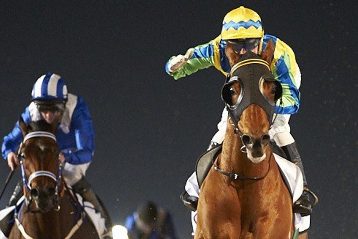 Gerald Mosse salutes as Rich Tapestry wins the Al Shindagha Sprint from Muarrab (Paul Hanagan). Photo: Dubai Racing Club