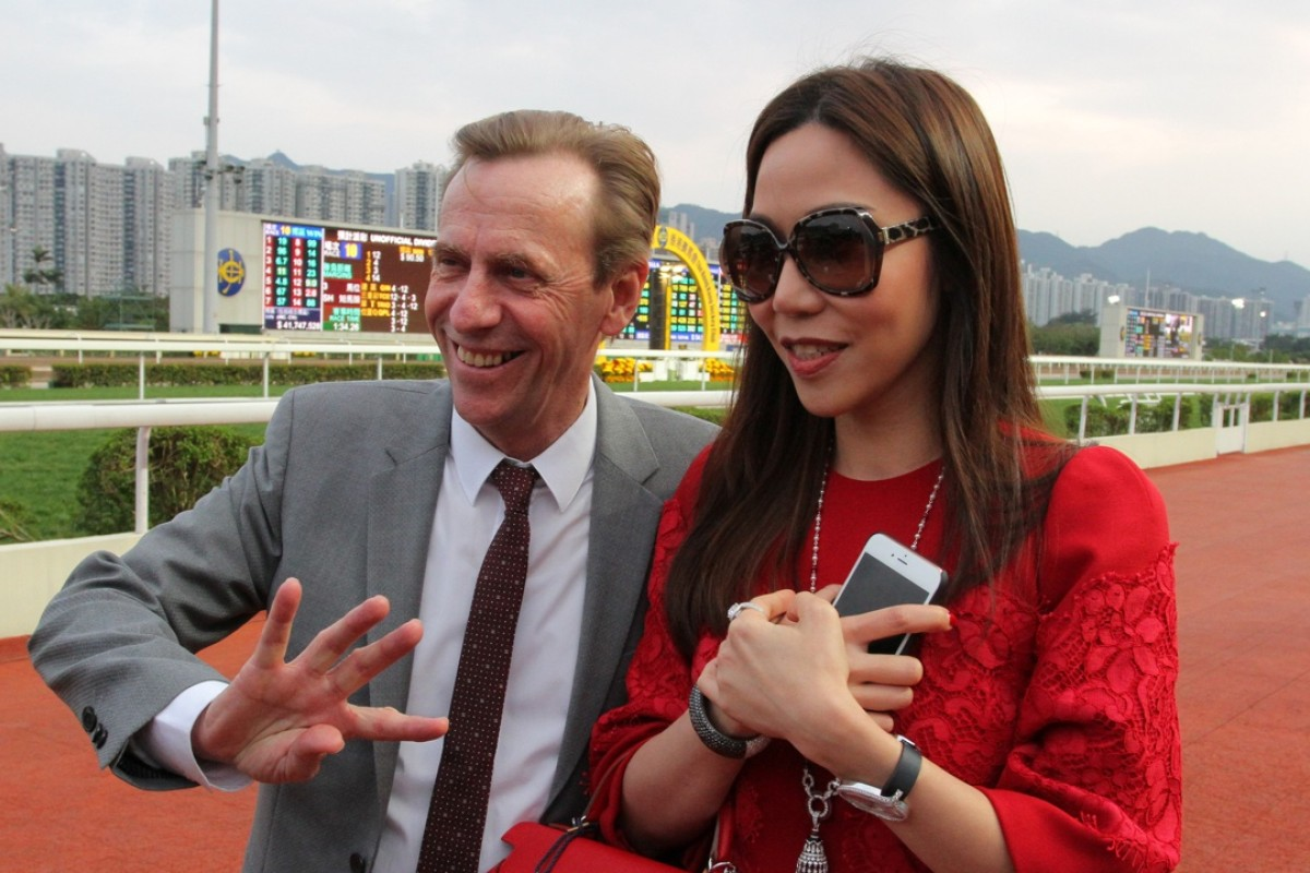 John Size and his wife Coco celebrate the trainer's four-timer after the last at Sha Tin on Sunday. Photo: Kenneth Chan