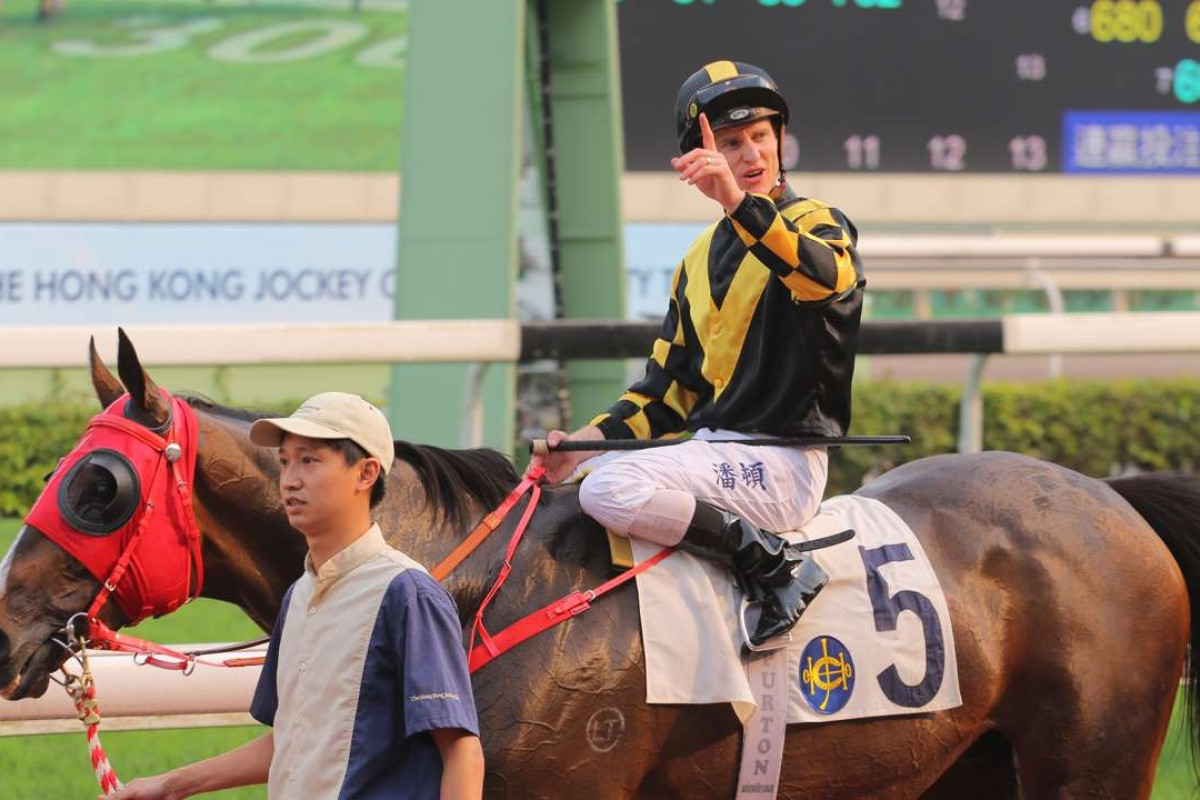 Zac Purton after winning on Rouge Et Blanc. Photos: Kenneth Chan