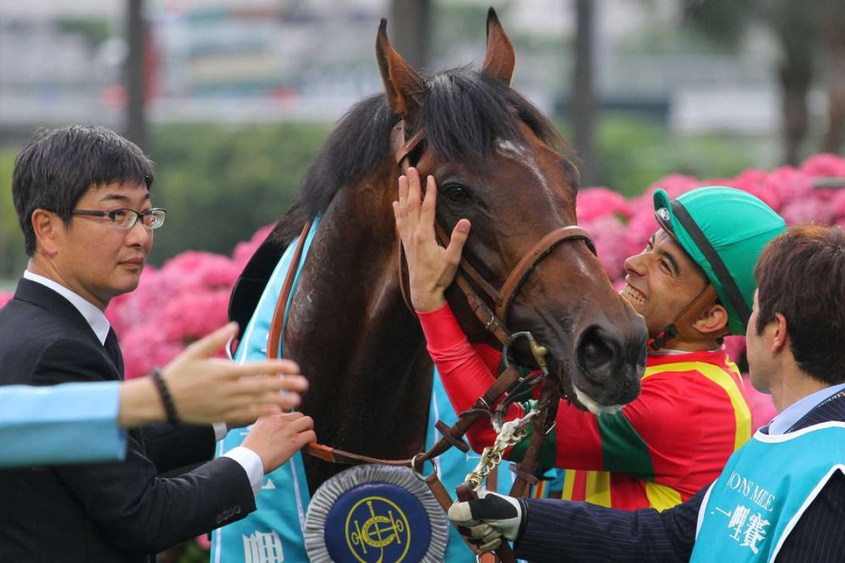 Joao Moreira gives Maurice a hug as trainer Noriyuki Hori looks on after the team combined to win the Champions Mile. Photo: Kenneth Chan