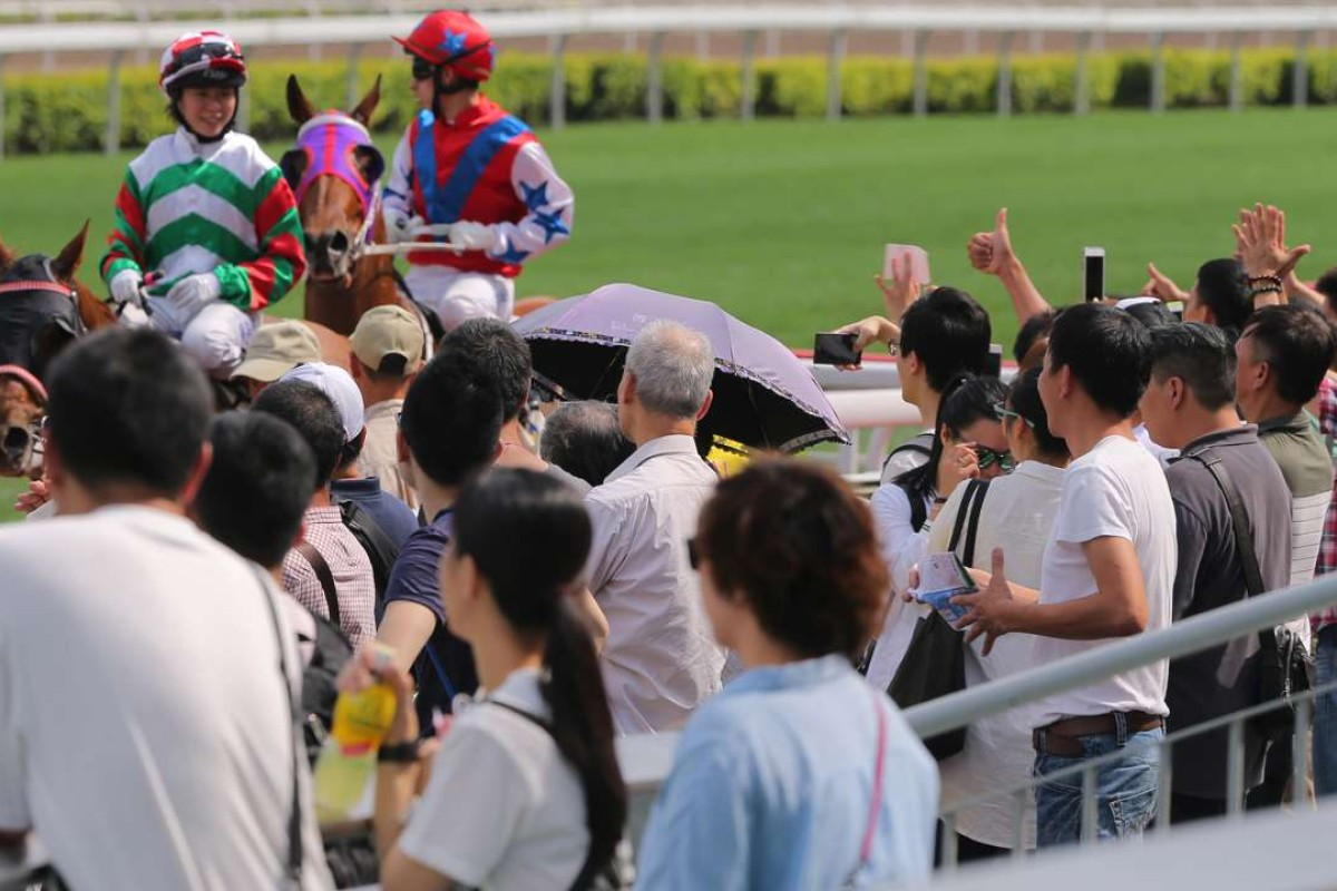 Kei Chiong receives a rapturous reception from the Sha Tin crowd as she returns on Molly's Jade Star. She is in line to not only win leading local rider, but also most popular jockey. Photo: Kenneth Chan