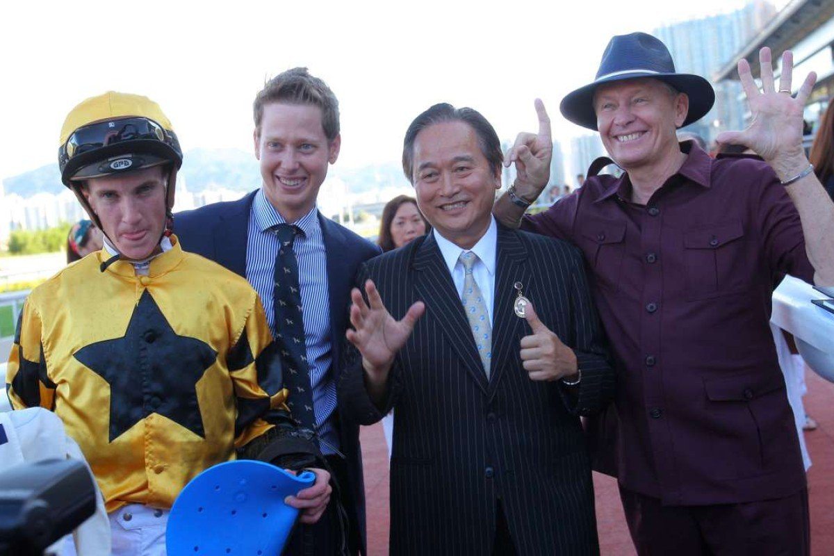 John Moore celebrates his 1,500th local win with Mr Bogart's jockey Chad Schofield, owner William Tsang and son George. Photo: Kenneth Chan