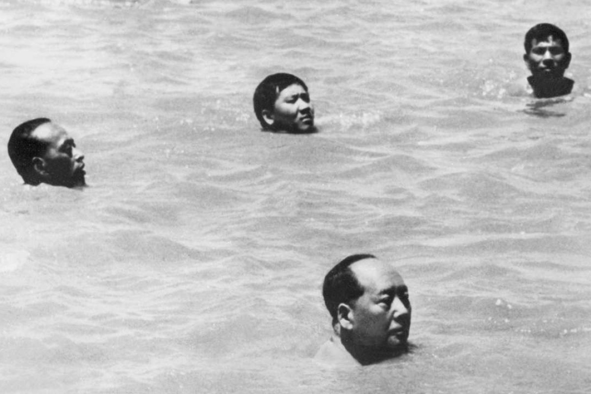 Chairman Mao Zedong (front), surrounded by his bodyguards, swims in the Yangtze River on July 16,1966. Picture: AFP