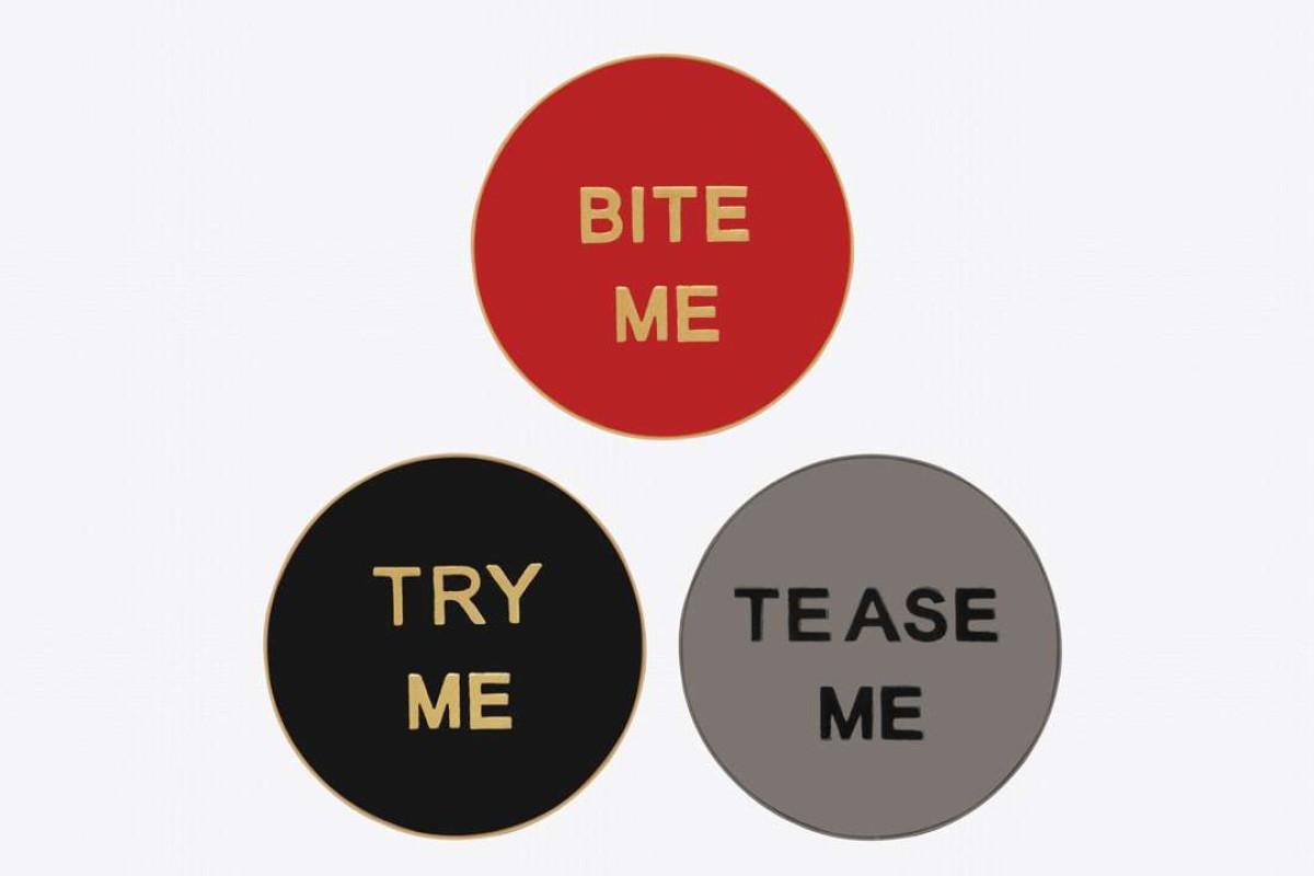 Pin badge set by Saint Laurent.