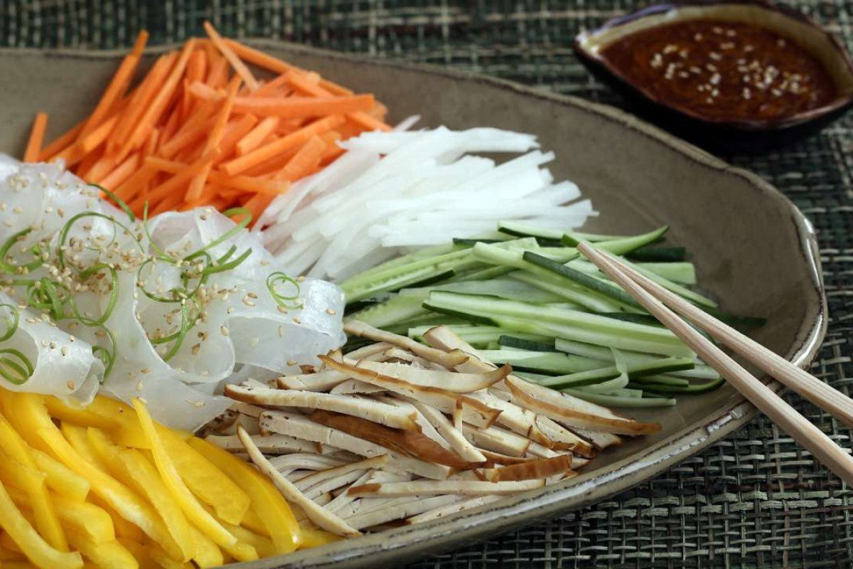 Mung bean noodles with vegetables, pressed bean curd and spicy sesame dressing. Photography: Jonathan Wong
