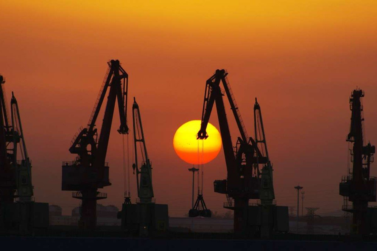 Cranes at Rizhao port in Rizhao, east China's Shandong province. The New Silk Road has to help China siphon off some of its record trade surplus. Photo: AFP