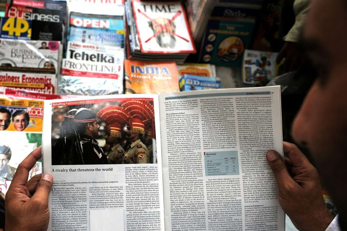An Indian reads a censored magazine at a road-side stall in New Delhi. Photo: AFP
