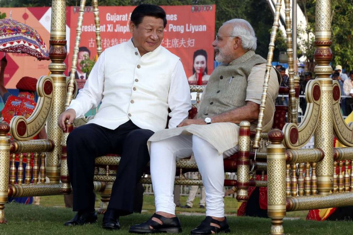 Chinese President Xi Jinping sits on a swing with Indian Prime Minister Narendra Modi at a riverside park in Gujarat in 2014. Photo: Xinhua