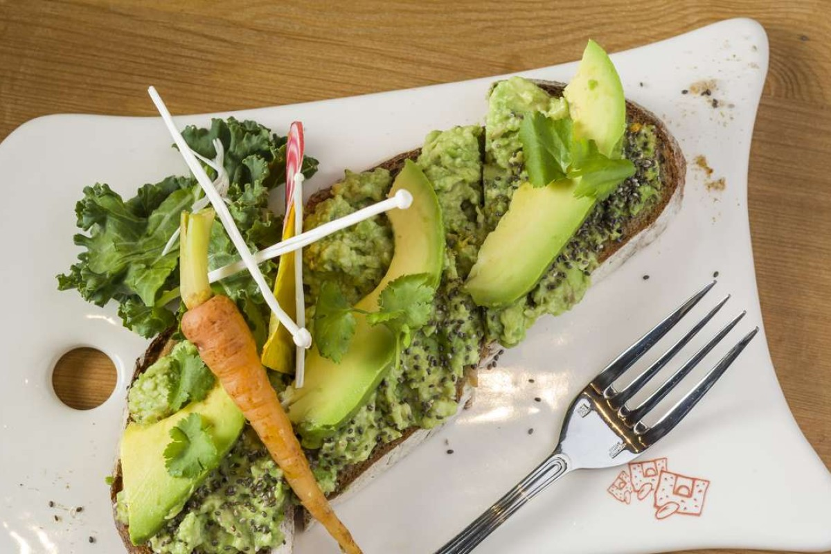 An Australian economist has created a storm by suggesting young people could climb on to the property ladder by saving on luxuries such as avocado on toast. File photo
