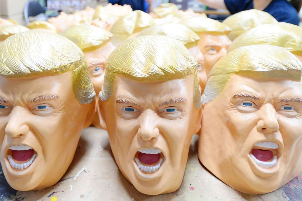 Rubber Donald Trump masks are produced at a factory in Japan. Photo: AFP