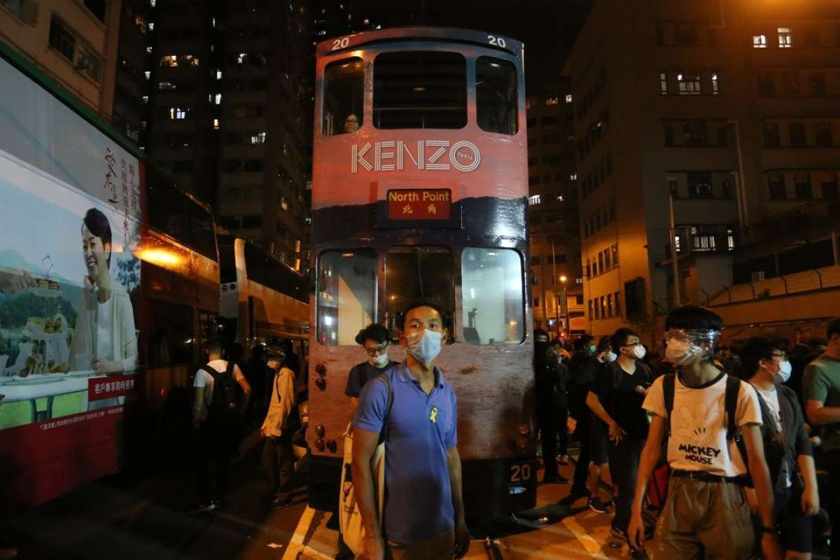 Protesters outside Western Police Station on Sunday evening in Hong Kong. There were repeated clashes between officers and protesters who had had broken off from an earlier, peaceful rally against Beijing's Basic Law interpretation over the Legco oath-taking row. Photo: AFP