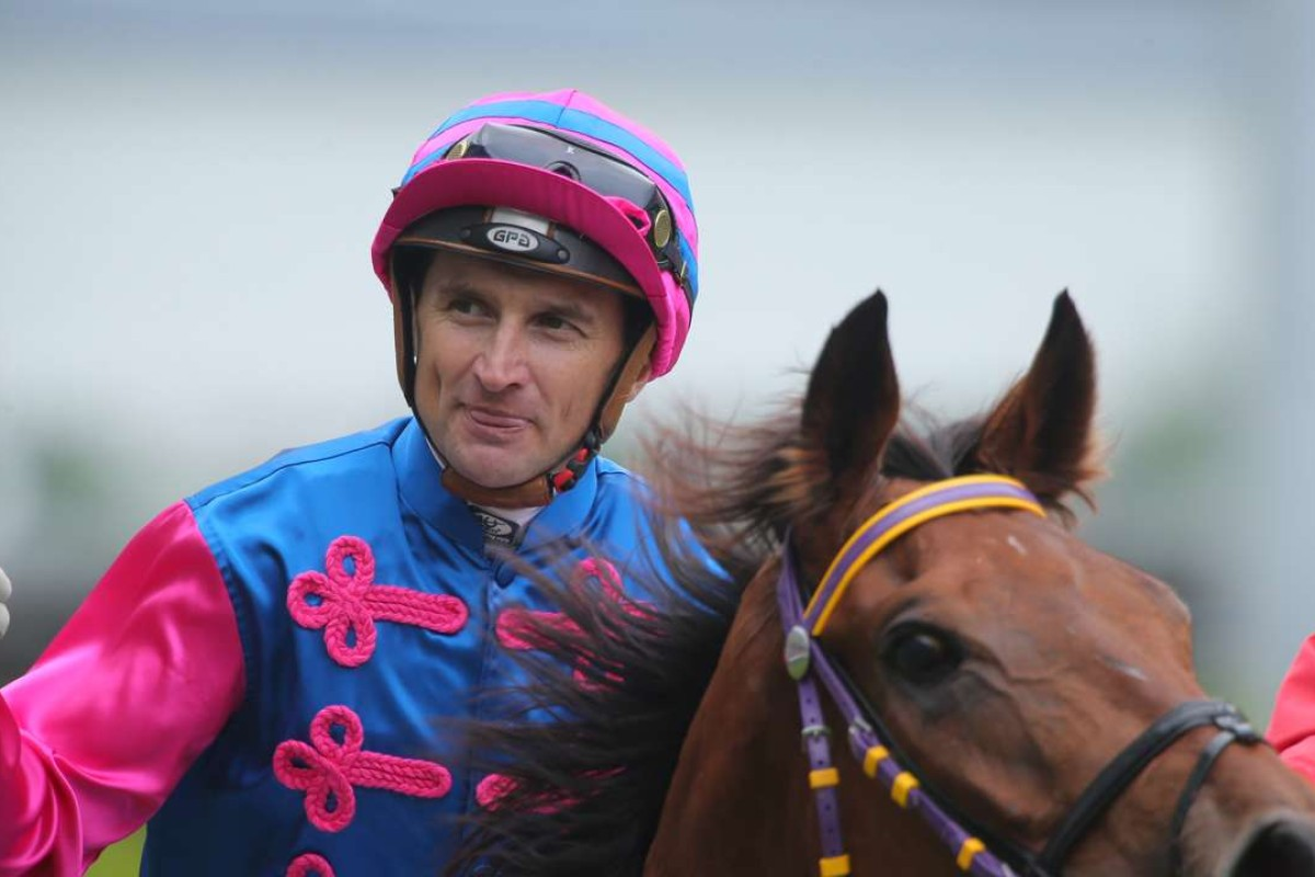 Opie Bosson gives the thumbs up after winning aboard Rapid Triumph. Photos: Kenneth Chan
