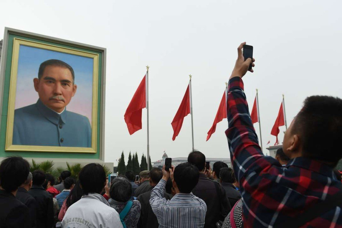 A man takes photos of a portrait of Sun Yat-sen in Beijing's Tiananmen Square. Photo: AFP