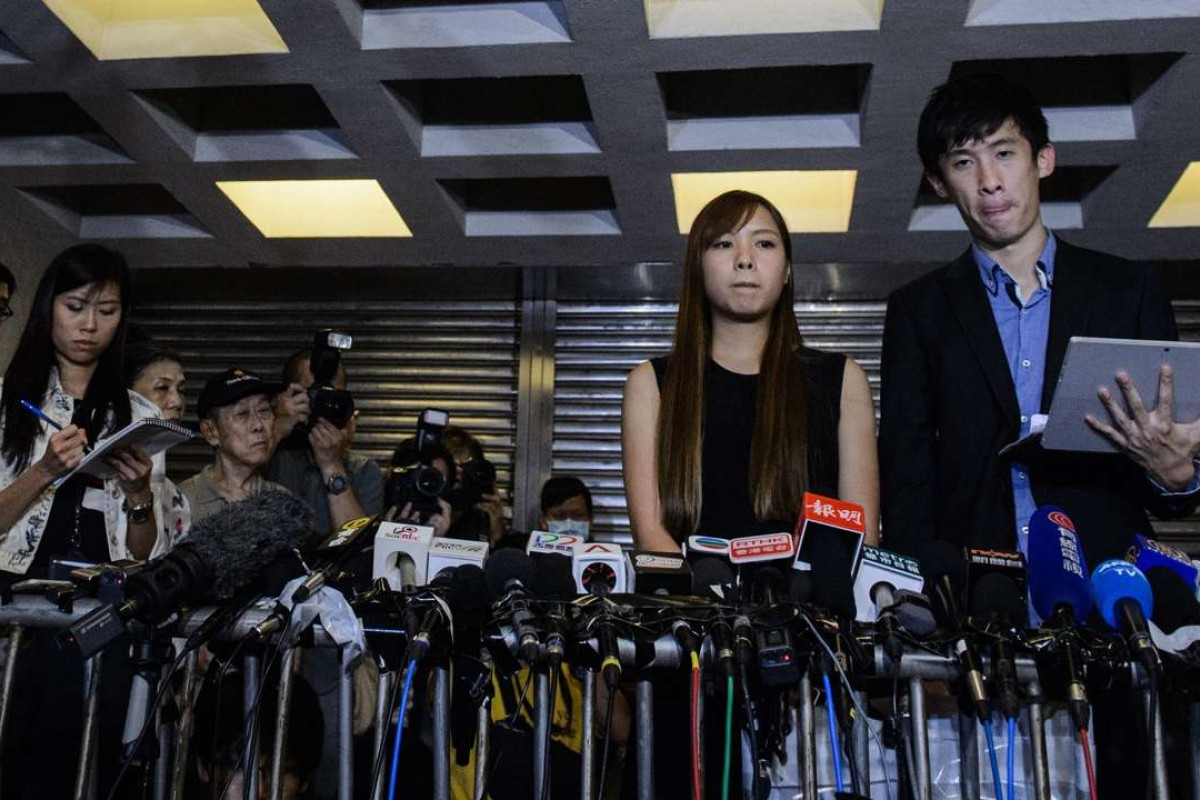 Pro-independence lawmakers Baggio Leung and Yau Wai-ching speak to the press outside the High Court in Hong Kong after a ruling that disqualified them from the Legislative Council. Photo: AFP