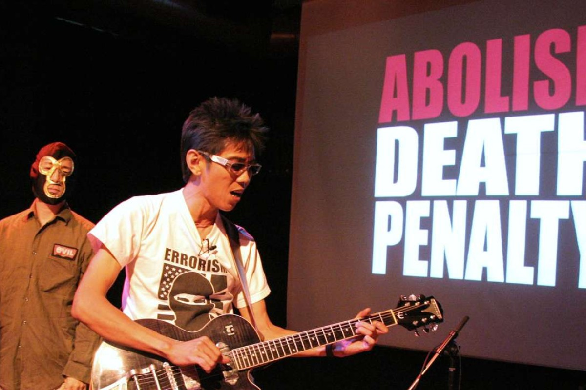A band calling for an end to the death penalty perform in Singapore. Photo: AFP